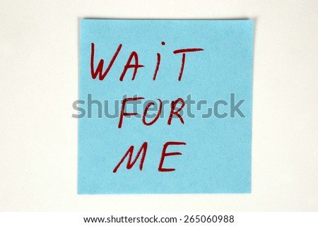 Wait for me written on color paper - stock photo