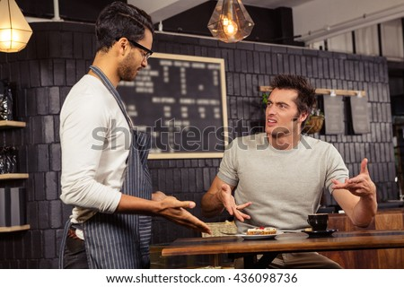 waiter customer having discussion coffee shop stock photo