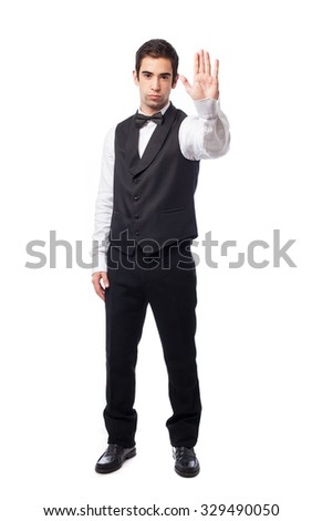 waiter doing a stop gesture - stock photo