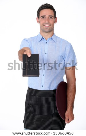 Waiter giving back a wallet - stock photo