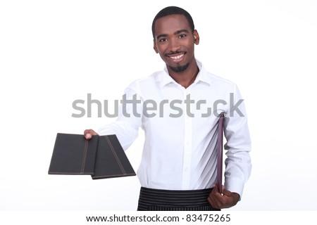 Waiter giving menus - stock photo