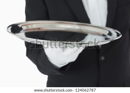 Waiter holding a silver tray in front of camera