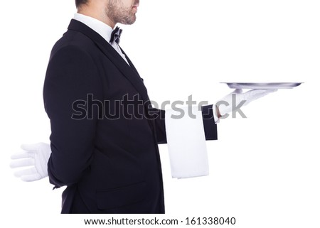 Waiter holding an empty silver tray, isolated on a white background
