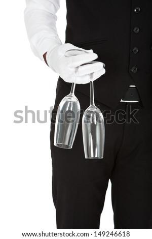 Waiter Holding Champagne Glasses Over White Background - stock photo