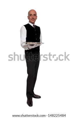 Waiter holding empty silver tray - stock photo