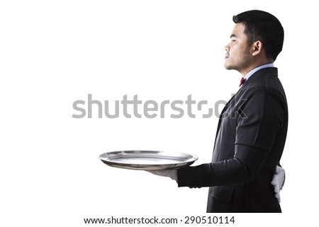 Waiter holding empty silver tray isolated on white background with clipping path - stock photo