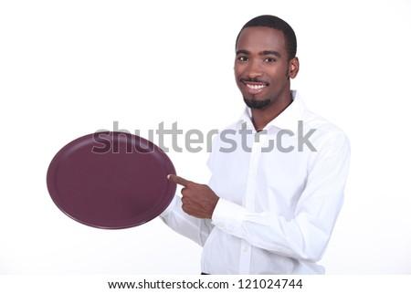 waiter holding tray - stock photo