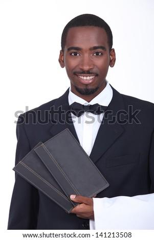 Waiter holding two menus - stock photo