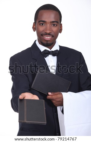 Waiter offering a menu