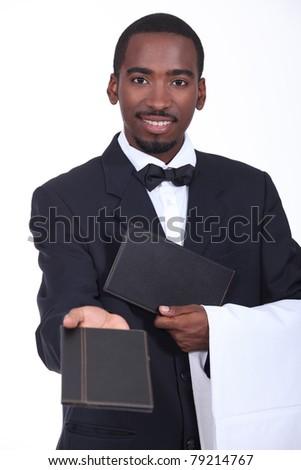 Waiter offering a menu - stock photo