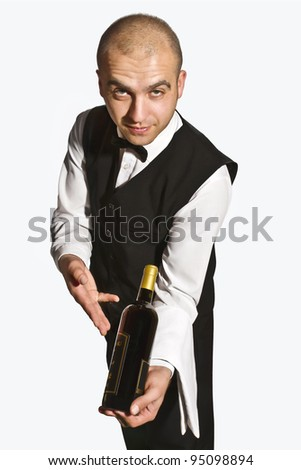 Waiter offers red wine