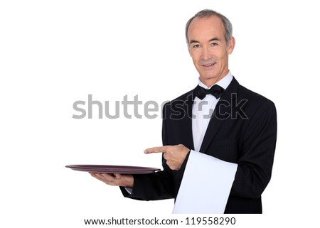 Waiter pointing to a tray - stock photo