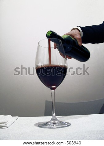 waiter pouring Red Wine,- very soft focus - stock photo