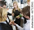 Waiter refilling his guests glasses with champagne - stock photo