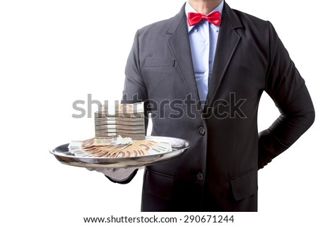 Waiter serving stack of million baht banknotes money thai  by silver tray the concept of business success property isolated on white background with clipping path - stock photo