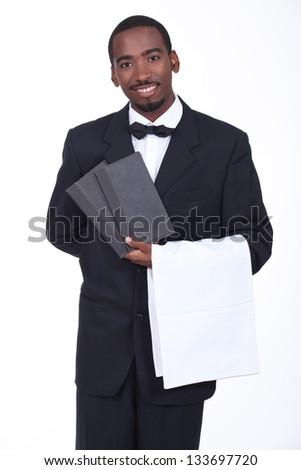 Waiter showing menus - stock photo