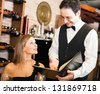 Waiter suggesting food to a woman in a restaurant - stock photo
