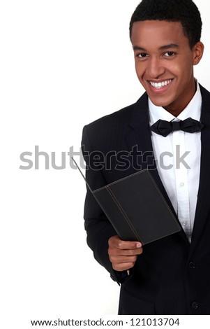 Waiter wearing tuxedo - stock photo
