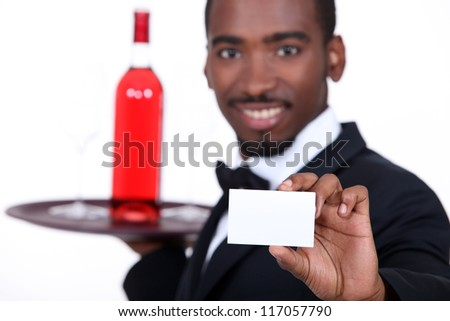 Waiter with a bottle of wine - stock photo