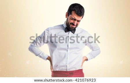Waiter with back pain