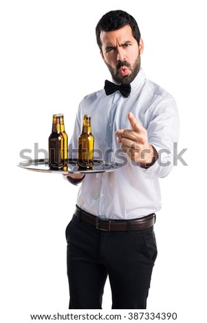 Waiter with beer bottles on the tray shouting