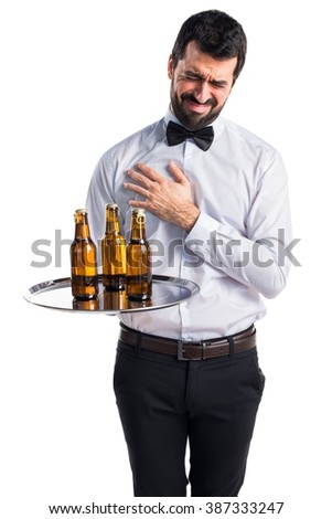Waiter with beer bottles on the tray with heart pain