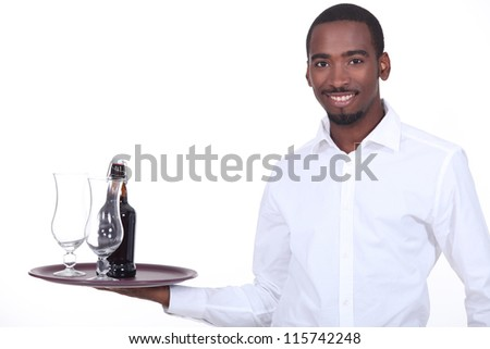 Waiter with beer on a tray - stock photo