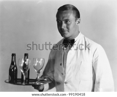 Waiter with beverages on tray - stock photo