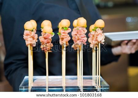 waiter with snacks - stock photo
