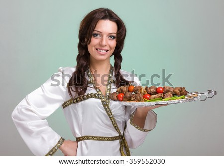 Waiters carrying plates with meat