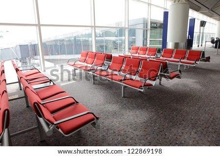 waiting area in the airport gate, row of red chair at airport, shot in asia - stock photo
