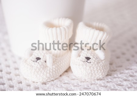 Waiting for baby white slippers - stock photo