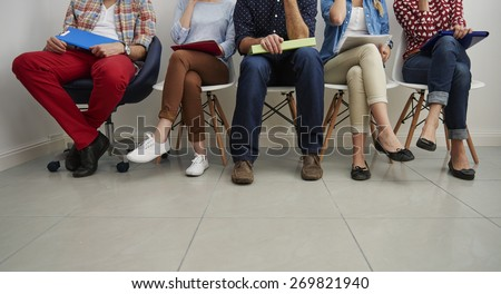 Waiting in the queue for job interview - stock photo