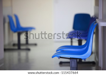 waiting room blue chairs, door on the floor - stock photo