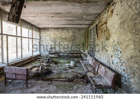 waiting room in no. 126 hospital in Pripyat ghost town, Chernobyl Nuclear Power Plant Zone of Alienation, Ukraine - stock photo