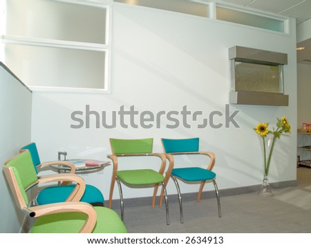 Waiting room with blue and green chairs