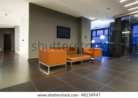 waiting room with orange leather furniture - stock photo