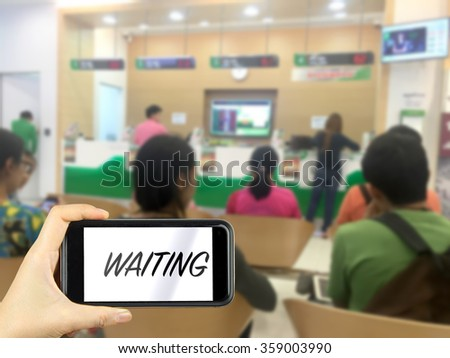 waiting. Taking photo on smart phone concept.