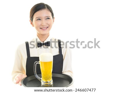 Waitress carrying beer