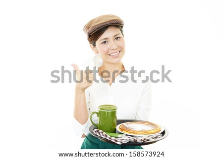Waitress delivering meal to table - stock photo