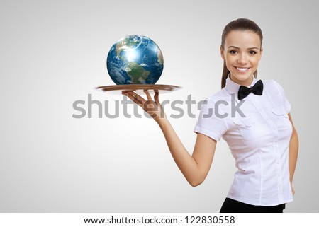 Waitress holding a tray with a symbol of green environment