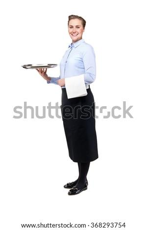 Waitress holding tray isolated over white background. Smiling. Whole person. - stock photo