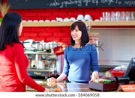 waitress serves customer in coffee shop - stock photo