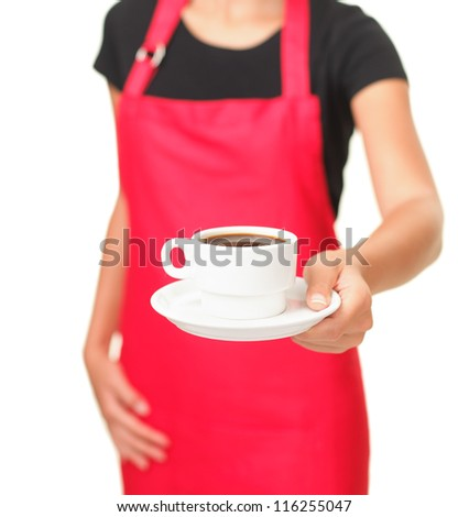 Waitress serving coffee cup. Close up of hand showing coffee isolated on white background.