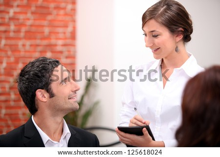 Waitress taking an order in a restaurant - stock photo