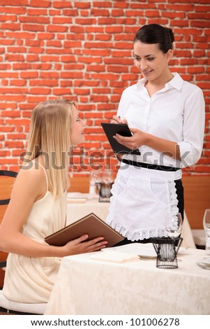 Waitress with customer