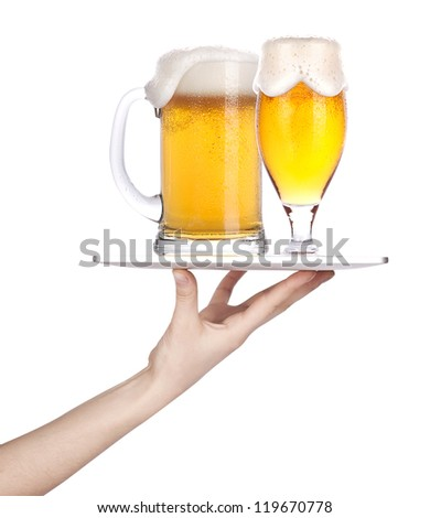 Waitresses hand holding a silver serving tray with a glass of beer. isolated - stock photo
