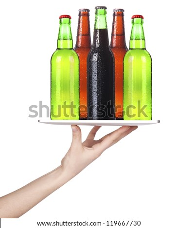 Waitresses hand holding a silver serving tray with beer. isolated