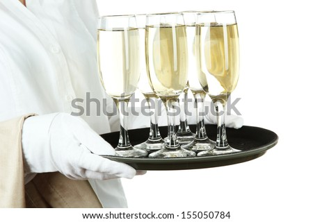 Waitresses holding tray with glasses of champagne, isolated on white - stock photo