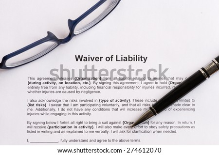 waiver of liability  on the white paper with pen - stock photo
